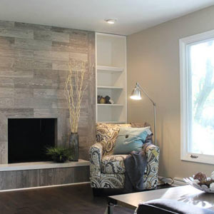 tiled wall with fireplace and chair
