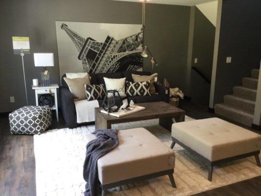 modern living room staging black sofa dn gray accents