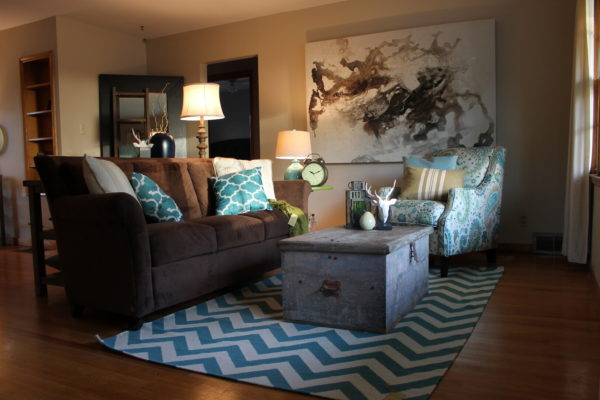 chocolate sofa with teal accents staging