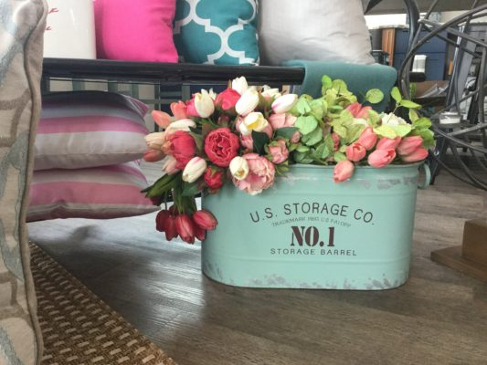 teal storage bin with floral décor