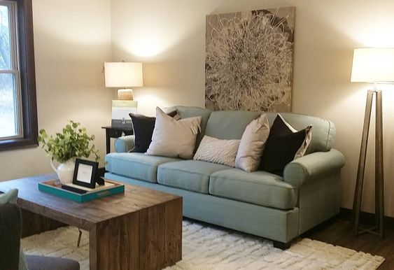 home staging blue sofa back and gray accessories white rug reclaimed table gray area interiors