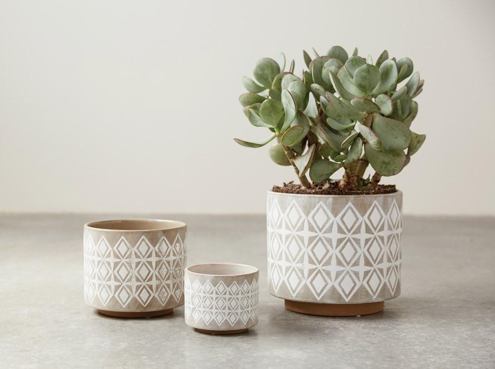 geometric pots with faux greenery