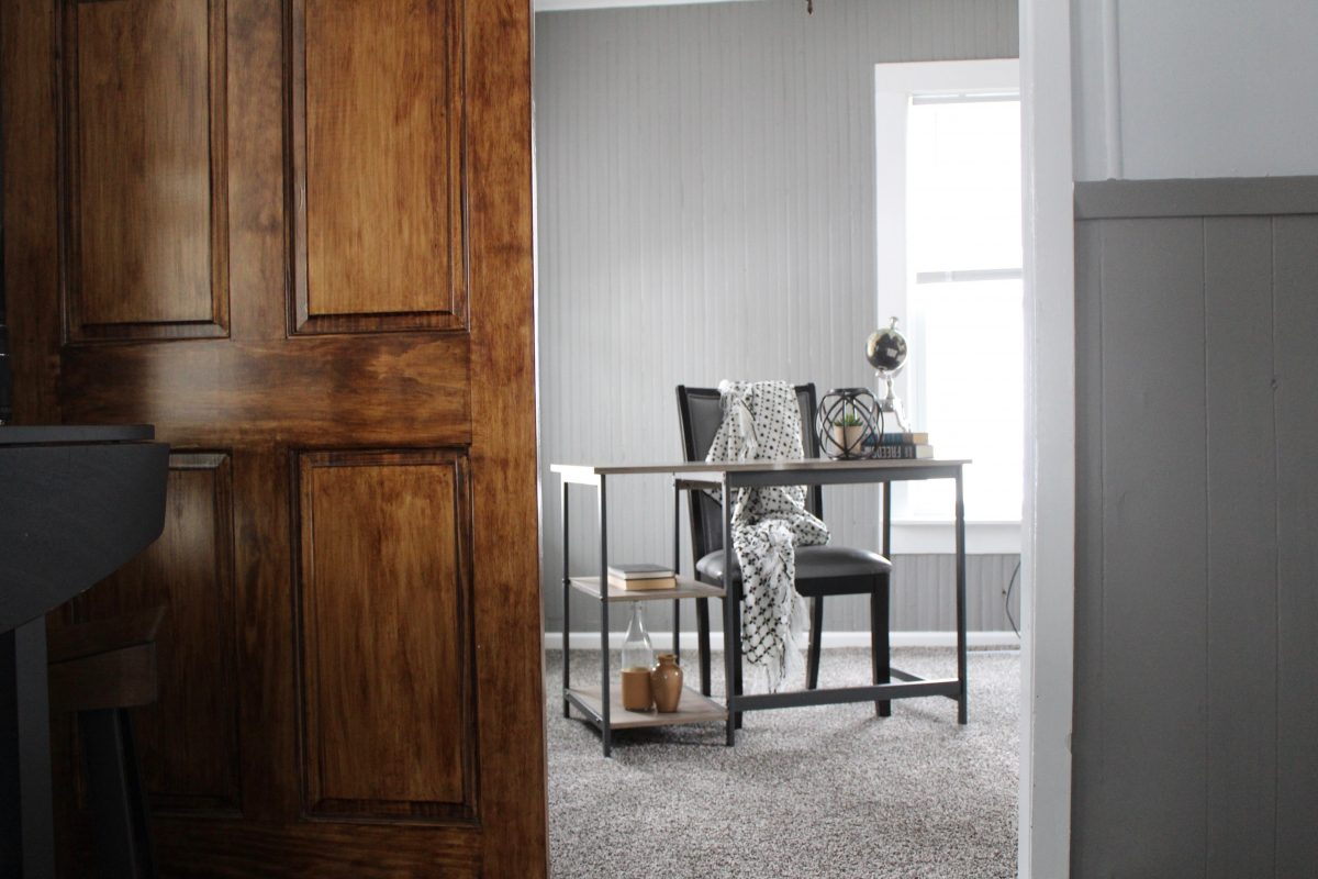 A soothing office with a unique barn door.